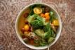 Chicken avocado salad over sweet potato soup