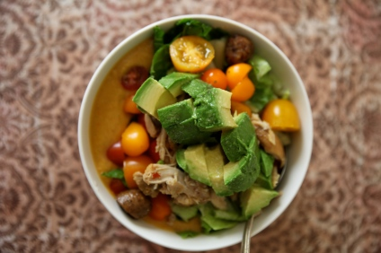 Chicken avocado salad over sweet potato soup